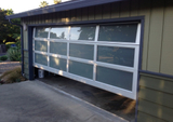What does the panel material of aluminium garage door have?